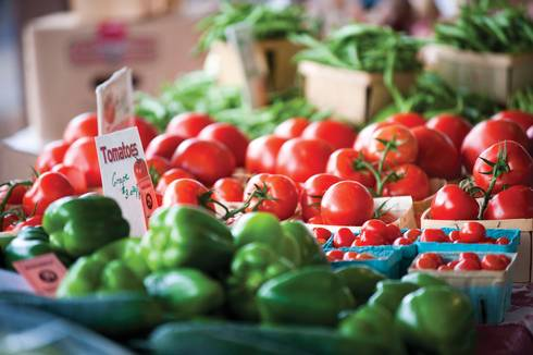 Tomatoes and green peppers at market
