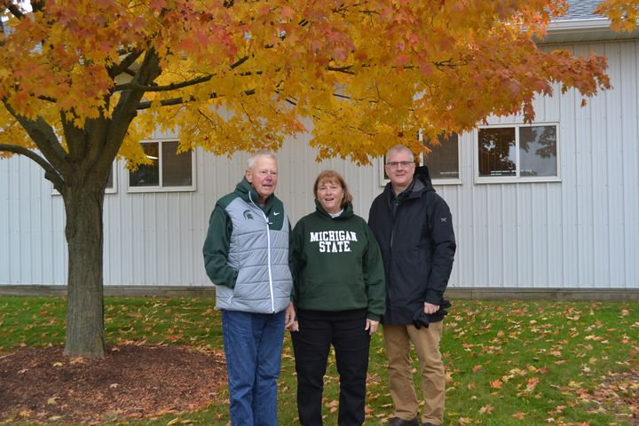 Carl Lindquist and Joy Vietinghoff with CANR Dean Ron Hendrick under a tree at the MSU horse farm.