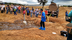 evin Erb, Conservation Professional Training Coordinator with University of Wisconsin-Extension, leading the Live Action Manure Spill Response demonstration at the 2015 North American Manure Expo in Chambersburg, Pennsylvania.