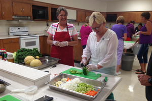 School nutrition staff participants at the Making Michigan Recipes Work training in Marquette learn skills for handling and preparing fresh Michigan produce.
