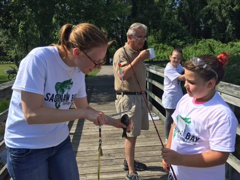 Michigan Sea Grant Extension educator Katy Hintzen works with youth at the Saginaw Bay Fishing Camp. Photo: Michigan Sea Grant