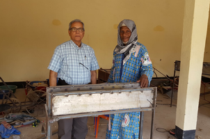 Ajit Srivastava (left) works with smallerholder farmers in Burkina Faso to help develop solar technologies for drip irrigation systems.