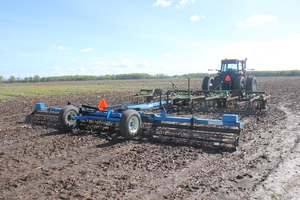Equipment parked in a wet field