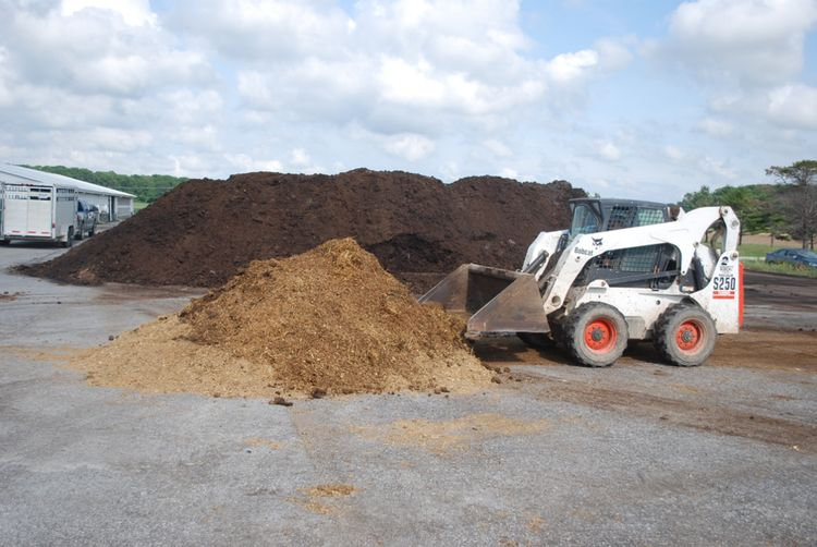 Skid steer working with compost.