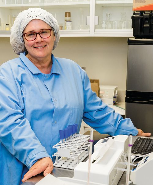 Tina Conklin, a food processing specialist at MSU, works on a project looking at shelf life and packaging concerns associated with uncured vacuum-packaged meat products.
