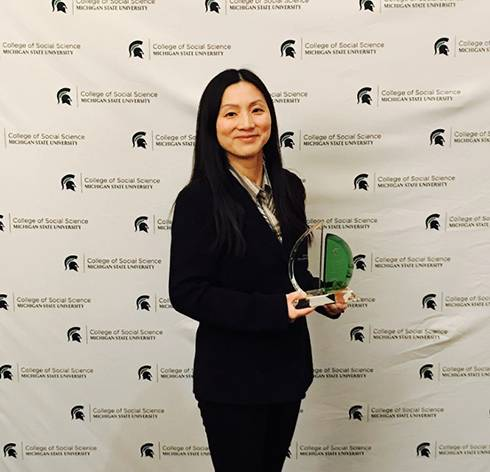 Image of Peilei Fan with her award.