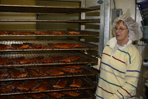 Jill Bentgen (Mackinac Straits Fish Company) with finished smoked fish product in her smokehouse. Ron Kinnunen | Michigan Sea Grant