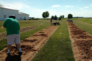 Genesee County Master Gardeners helping to establish flowering trees and shrubs at the Saginaw Valley Research and Extension Center.
