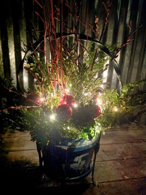 Add an outdoor floral arrangement to your holiday decorating.