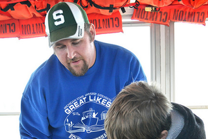Michigan Sea Grant program instructor Justin Selden spends a lot of time working with students while on the schoolship and touring lakes St. Clair and Detroit. Photo: Michigan Sea Grant