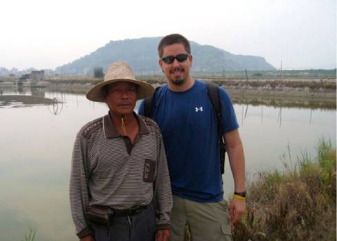 David Ortega poses with a Chinese farmer in Fujian Province, China, in 2011.