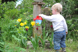 Gardening with young children helps their development
