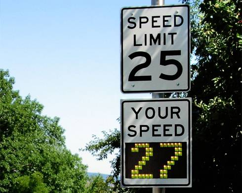 Photo of a speed limit sign with a