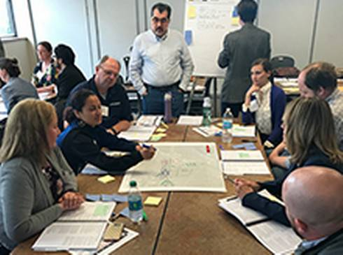 Group working together during a 2018 NCI charrette in Detroit.