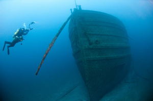 A NOAA diver documents the bow of the wooden freighter Florida. Photo: NOAA/Thunder Bay Marine Sanctuary