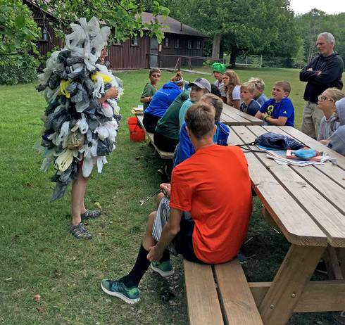 The Bag Monster talking with campers about plastic pollution.