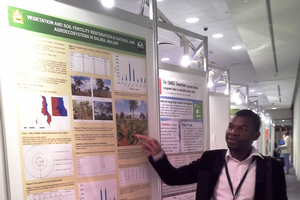 Harrington Nyirenda presents his poster.