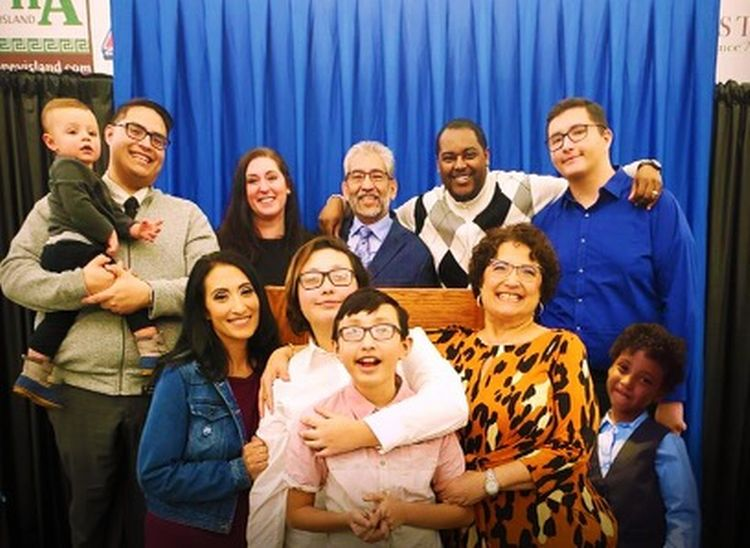 Dionardo Pizaña (back center), a diversity, equity and inclusion specialist for Michigan State University Extension, and his family.