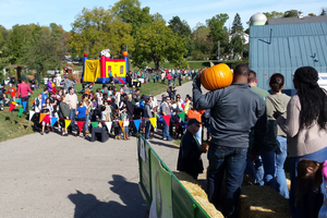 Guests at the 2015 Pumpkinfest enjoy a fall day at the Tollgate Farm and Education Center. Photo: Alan Jaros, MSU.