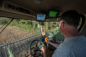 Jeff Sandborn monitors his GPS equipment while harvesting