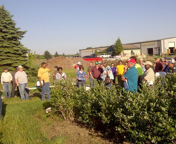 Blueberry growers listen to herbicide results and herbicide demonstration plots near South Haven, Michigan. Photo: Mark Longstroth, MSU Extension.