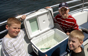 Ella White Elementary students venture out onto the waters of Lake Huron to release Lake Trout raised in their classroom in connection with Thunder Bay Reef Restoration Effort.Bob Thompson | Alpena Public Schools