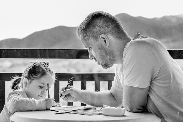 Girl and father coloring