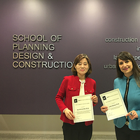 Image of Suk-Kyung Kim and Linda Nubani holding certificates.