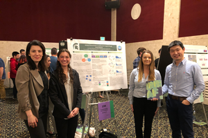 Construction Management faculty members Sinem Mollaoglu and Dong Zhao with students Patty Giradot and Carolyn Whiting standing with their award-winning poster at the 21st UURAF.