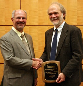 Phil Robertson (right) accepts the 2010 AIBS Distinguished Scientist Award on behalf of the LTER Network from AIBS President Jos