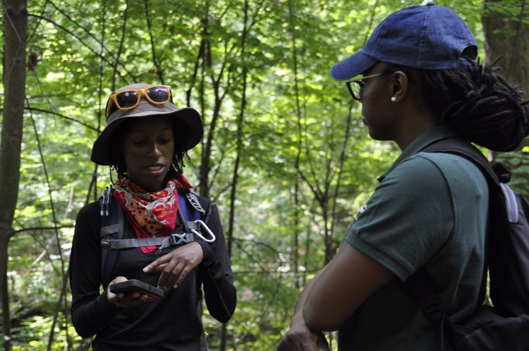 MSU Forestry graduate student Alex White talks with Forestry professor Asia Dowtin in Bancroft Park. Dowtin is mentor in the CANR Multicultural Apprenticeship Program.