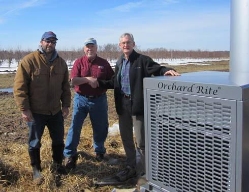 CRC assistant farm manager Dan Platte (left) and MSU professor Gregory Lang (right) thank Lee DeLeeuw for the wind machine.