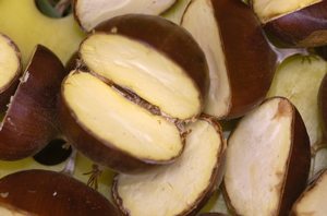 Chestnuts split to reveal healthy meat.