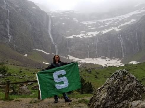 Emily with MSU flag.