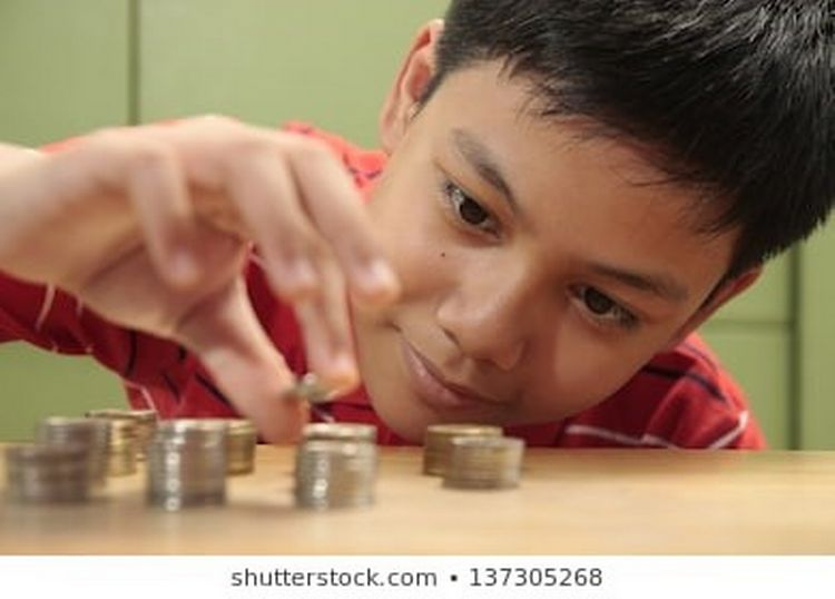 Boy counting change