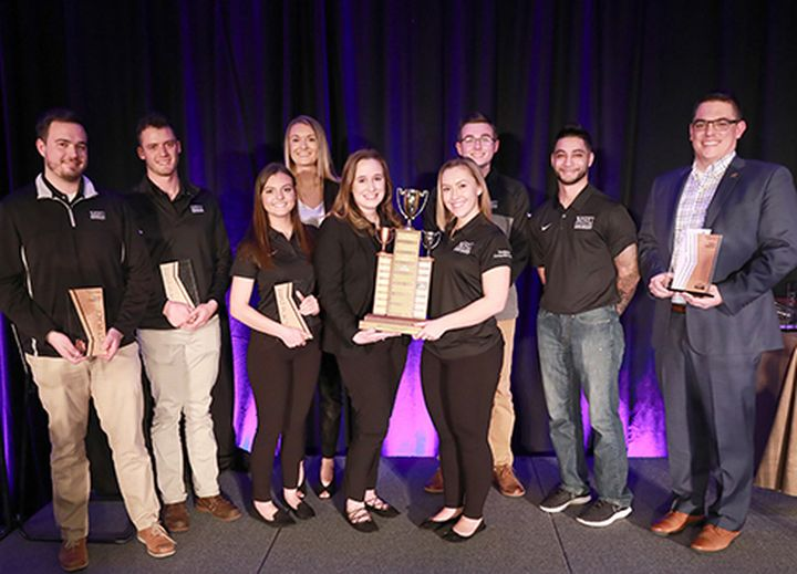 Image of students and faculty with the 1st place award.