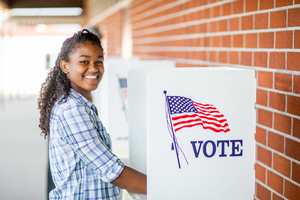 Young woman in a voting booth