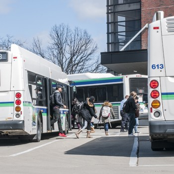 CATA bus riders exiting bus at transit station. Photo by MSU CABS.