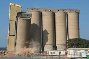 Photo of the demolition of a farm silo.