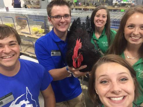 Tom led fellow State Youth Leadership Council members on a tour of the state fairgrounds, including a stop with his rooster Fred. Left to right: Loren King, Tom Purves, Samantha Beaudrie, Emily Kittendorf and SYLC co-facilitator Makena Schultz.