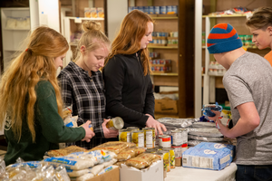 Youth sort through food items