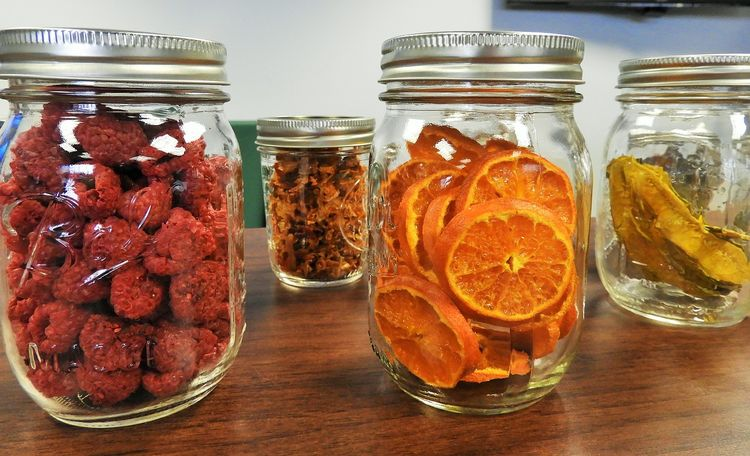Various mason jars of canned fruit.