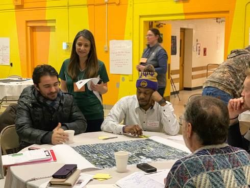 Photo of group working together at Lansing placemaking and crime prevention charrette.