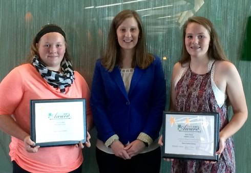Jolene Griffin (center) from United Dairy Industry of Michigan with Senior 4-H State Award winner Julia Doughty (left) and Junior 4-H State Award Winner Anna Moser (right).