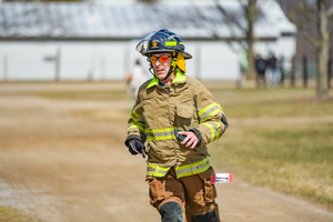 Bob Bates ran in his full firemen's personal protective gear at the 2018 Hoofin' it for Horses 5k event. Photo by Dane Robison, TimeFrame Photography.