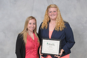 Shelby Berens, 2015 Senior State Award Winner in Dairy Science, with Brianna Banka of the United Dairy Industry of Michigan. The 4-H dairy program thanks the United Dairy Industry of Michigan for sponsoring this award.