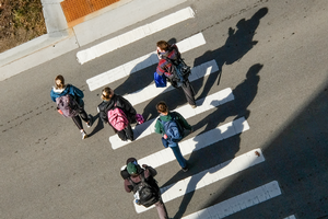 Image of students crossing a crosswalk.