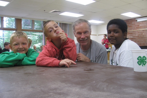 Talon and Tom (center) with two other youth at Michigan 4-H Mentoring Weekend.