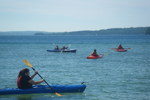 Life of Lake Superior youth kayaking on South Bay out from Munising, MI. (Photo by MSU Extension)