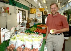 Mike Hamm standing in a produce market
